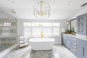 White Marble bathroom with custom bathtub and lighting