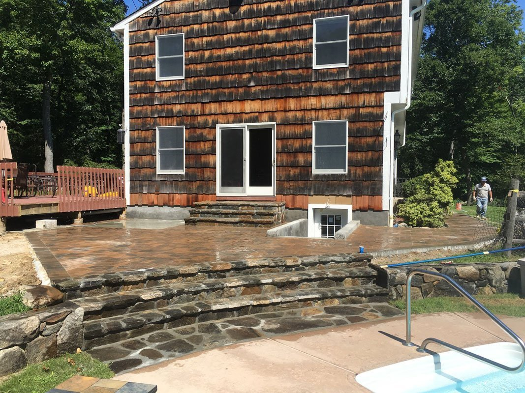 Patio Construction with steps leading to pool
