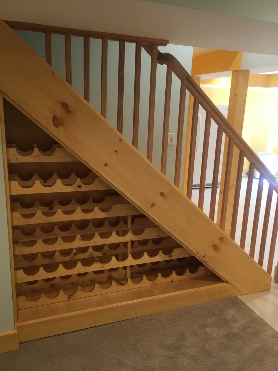Under stair Wine rack built by Finishing Touch