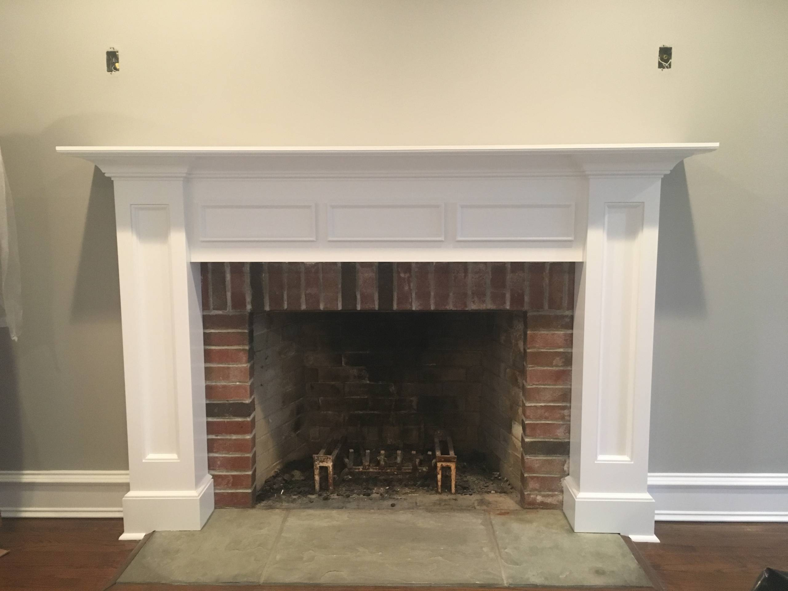 Brick Fireplace with Mantle built by Finishing Touch
