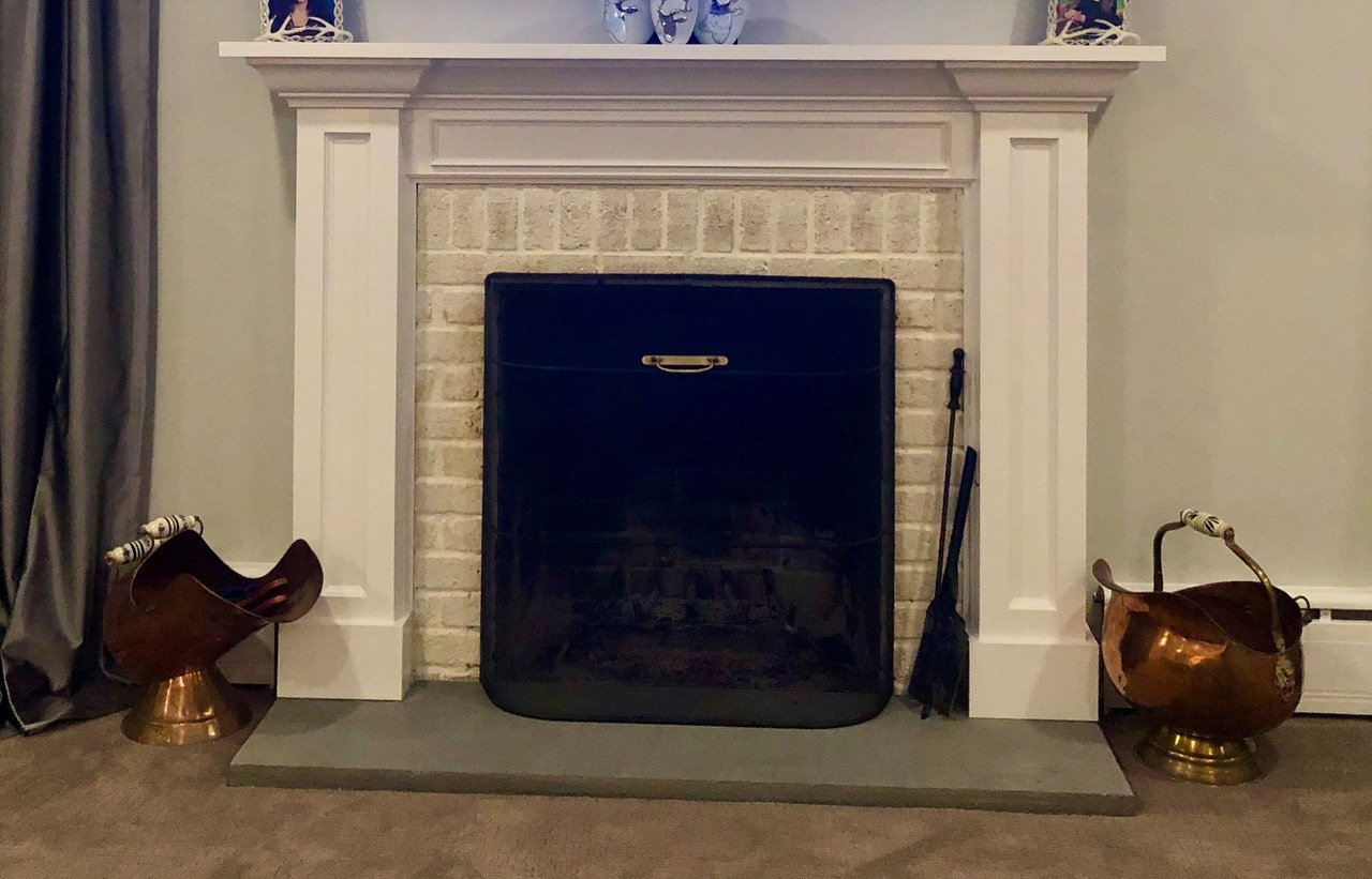 White Brick fireplace with custom mantle by Finishing Touch