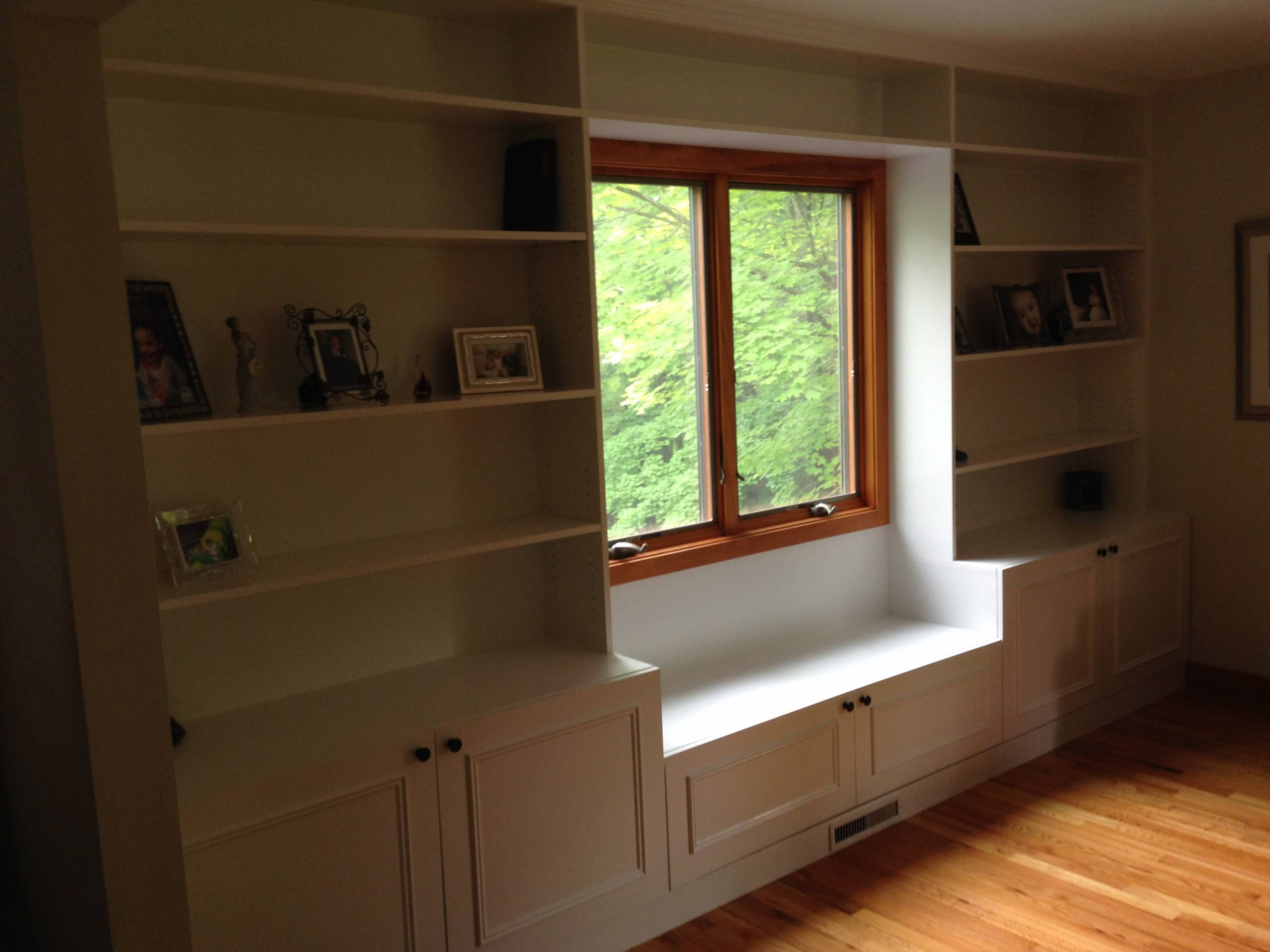 Window seat with built in bookshelves by Finishing Touch