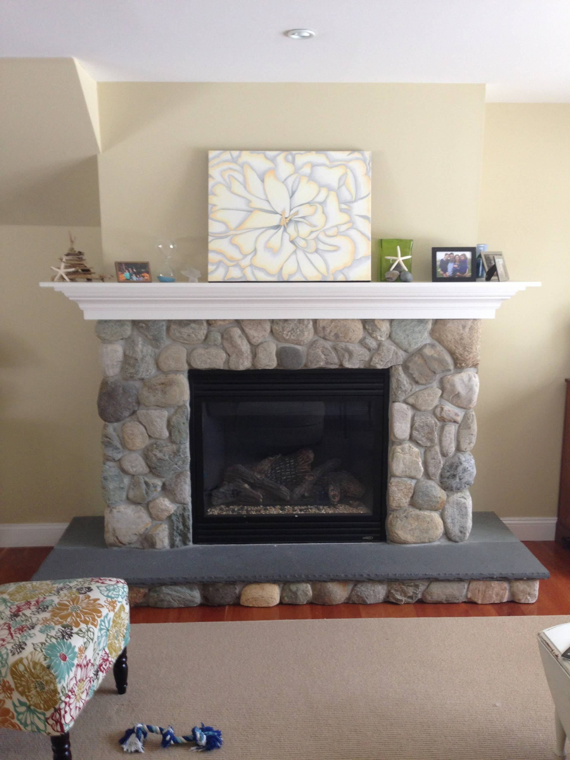 Stone Fireplace with custom mantle by Finishing Touch