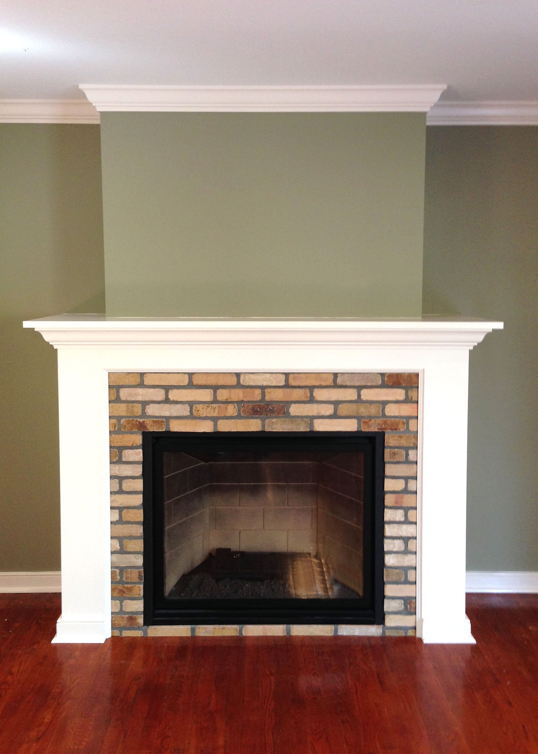 Custom fireplace and mantle by Finishing Touch Contracting Inc.
