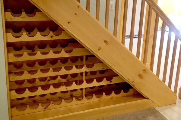 Custom under-stairs wine rack